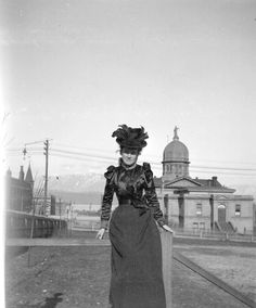 Woman on Pender Street in front of court house, 1898 (Now Victory Square) Source: City of Vancouver Archives
