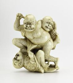 Netsuke of carved ivory, a lying man and a standing man attacked by a man with a grotesque expression and a stick: Japan, by Zemin