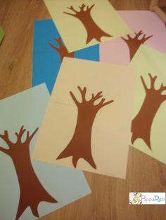 prendi tanti fogli colorati e disegna un albero con qualche ramo