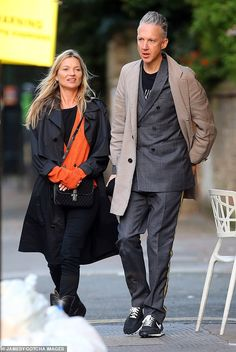 Looking good: Opting for an effortlessly stylish appearance, the catwalk queen teamed a vibrant orange cardigan with classic black jeans and patent knee-high boots Sam Taylor Johnson, Moss Fashion, Kate Moss Style, Miss Moss, Orange Cardigan, Catwalk, Celebrity Style, Black Jeans, Bomber Jacket