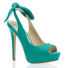 Hailey in turquoise-- Say hi to Hailey, a supple peep-toe slingback with a lush fabric accent bow.
