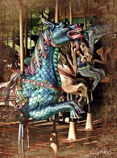 "© Susan M. Hembree ""Antique Carousel"" Description: A recreation of a newer carousel into an antique carousel & older vignetted photo.  Lots of work in PSCS including use of Topaz Adjust filter, layering in of a Victorian texture that has been vignetted & color burned blended, vintage and crackle textures that have been vignetted. Various adjustments with contrasts and colors."