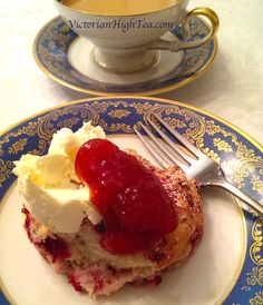 VictorianHighTea.com Raspberry scone with clotted cream and strawberry jam. And tea. Of course!