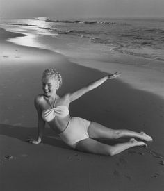 ANDRE DE DIENES (American, 1913-1985) Marilyn Monroe on Tobey Beach, 1949