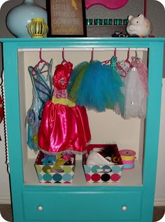 An old dresser turned into a little girl wardrobe for dress up clothes