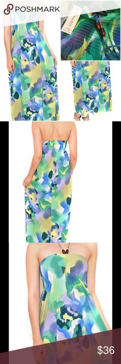 """By Polkadot """" Mandy Dress in Green !  By Polkadot the """" Mandy Dress in Green """" ! Maxi Dress ! 100% Polyester ! Beautiful colors ! Tie in front center with wooden beads ! Length is about 48 inches ! Strapless ! Bodice smocked all elastic ! Bodice stretches ! Runs small ! This is more like a small would probably fit extra small too ! Bodice laying flat not stretching it is about 24 inches ! Lightweight ! The true colors are in picture I took with label ! Pretty summer maxi dress !  Polkadot…"""