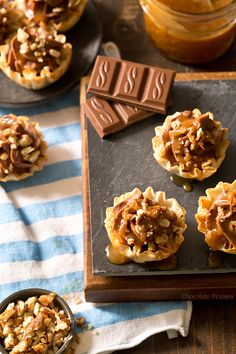 Looking for a bite-sized dessert to share with family and friends? These easy-to-serve No Bake Turtle Cheesecake Phyllo Cups with chocolate, caramel, and pecans will be a popular hit!