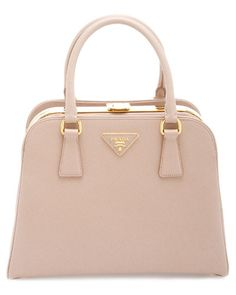 Beautiful Prada bag in blush with gold hardware. I <3 her.