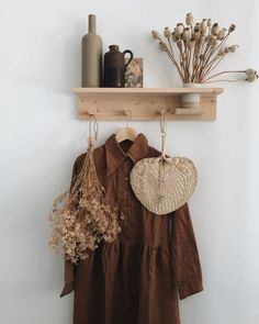 a natural home in the netherlands. raffia fan and terracotta dress hung from simple wood shelf. Living Room Decor, Bedroom Decor, Wall Decor, Whats Wallpaper, Deco Boheme, Mediterranean Decor, Interior Decorating, Interior Design, Interior Modern