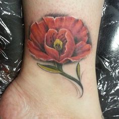 poppy tattoo by artist Daniel Jones of Asylum Studios in Roanoke, VA.