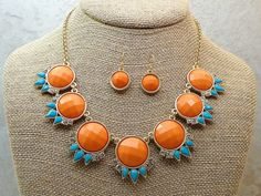 I found this on www.rmcjewelry.com Coral and Turquoise Statement Necklace