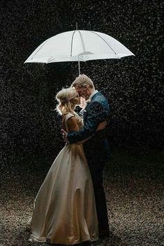 night wedding photos under the rain bride and groom with an umbrella nick photography