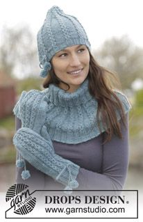 """Maggie Blues - Set consists of: Knitted DROPS hat, neck warmer and mittens with small cables, purl stitches and pompoms in """"Karisma"""". - Free pattern by DROPS Design Blue Mittens, Crochet Mittens, Mittens Pattern, Knitted Gloves, Knitted Blankets, Knit Crochet, Crochet Hats, The Mitten, Drops Design"""