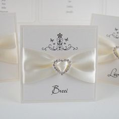 Exclusive handmade wedding place cards and gorgeous luxury wedding stationery handcrafted in the UK by Wedding Invitation Boutique. Established 2006.