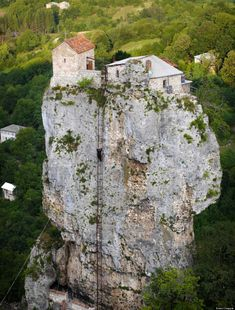 Maxime Qavtaradze is literally close to the heavens. The 59-year-old monk lives atop a stone pillar in Georgia, scaling a 131-foot ladder in order to leave and enter his lofty home, reports CNN. Photographer Amos Chapple ascended the cliff to photograph his life there.