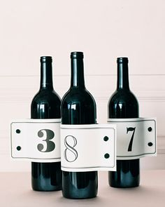 Dress your wine bottles with table number labels that mimic shirt cuffs