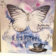 """Following #maremismallart tutorials on """"How to break a blank page"""" and made this. Drops from acryllic spray and some water, adding a butterfly and some stamps - and voilà 👍 The card is done! Insta: @KreaTine_"""