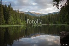 "Download the royalty-free photo ""Lake in the mountains"" created by EMSI at the lowest price on Fotolia.com. Browse our cheap image bank online to find the perfect stock photo for your marketing projects!"