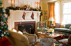 Greenery, nutcrackers, and Christmas balls festoon the mantel, and needlepoint stockings add handcrafted whimsy. - Traditional Home ® / Photo: John Bessler / Design: Anthony Catalfano