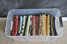 Fabric storage with comic book boards. Great idea!