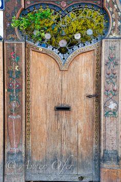Vine-filled heart above door.