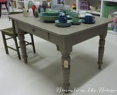 Old Farm Table.  Top has had restoration, gorgeous chunky turned legs, and centre drawer on one side.  Hand-painted in Chalk Paint TM decorative paint by Annie Sloan in French Linen.  Then finished with Clear waxes. (has a price tag on it, contact us to inquire).