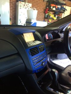 If you've got easily removable fascia panels within the interior, vinyl wrap and PlastiDip are good options for a cheap and attractive cosmetic upgrade, as opposed to forking out for aftermarket replacements. Pictured here is the ICC unit from the XR6, the panels have been removed and sprayed with blue plasti-dip, and the vinyl wrap to the side of has a carbon fibre pattern, which is quite a popular car trend on the street at the moment.