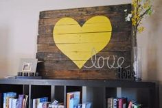 Recycled wood pallet artwork ~ huge yellow heart. Gina, I have a wood pallet in the garage....this would be cute in the your study