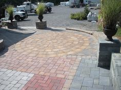 This Cambridge driveway features a beautiful mix of colors and patterns.