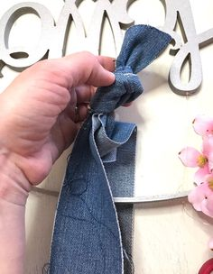 She ties a knot with a strip of denim & makes THIS front door idea
