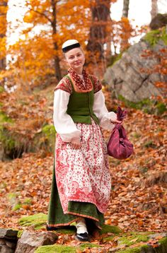 The wool bodices and skirts are trimmed with silk ribbon. The skirt is printed with an intricate pattern and the white stockings are beautifully embroidered - Norway