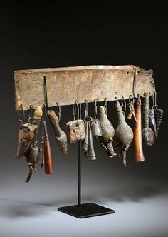 Africa | Ceremonial belt of a medicine man, from the Fang people of Gabon | Leather with a number of amulets made from animal bones, ivory, metal and filled leather pouches | Mid 20th century