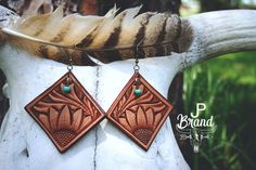 Hand tooled leather earrings  $43 https://www.etsy.com/shop/JPBrand