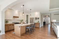 Stained and painted cabinets, quartz counters, open floor plan Oakland Hills, Quartz Counter, New Homes For Sale, Painting Cabinets, Open Floor, Condominium, How To Take Photos, Floor Plans, Flooring