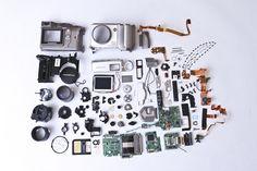 Olympus camera disassembled / Matt Edwards