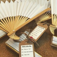 Paper fans as wedding favours to cool guests during the service at my #summerwedding   #orderoftheday tags attached.