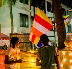 Peering over the parapet to see the Vesak celebrations at the Pinwaththa Temple.  #KnowSL #SriLanka #Vesak #Lanterns #FestivalofLight #SriLankaTravel  Copyright © Crintech Pvt Ltd.