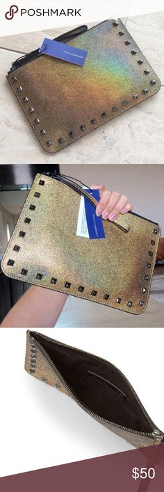 Rebecca Minkoff studded wristlet New with tags! Gorgeous gold iridescent leather Kerry clutch with gunmetal studs, zip closure, wrist strap. Genuine leather, cotton twill lining. Great for going out or carrying in a larger bag. No trades. Rebecca Minkoff Bags Clutches & Wristlets