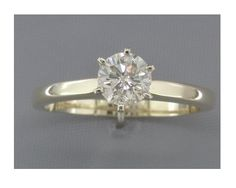 '0.59 cts Diamond Solitaire Engagement Ring 14Kt Gold' is going up for auction at 12pm Fri, Oct 26 with a starting bid of $1500.