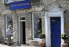 Yellow-Lighted Bookshop in tetbury, Gloucestershire