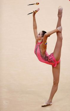 Ukraine's Alina Maksymenko competes using the clubs in her individual all-around gymnastics qualification match at the Wembley Arena during the London 2012 Olympic Games August 10, 2012.
