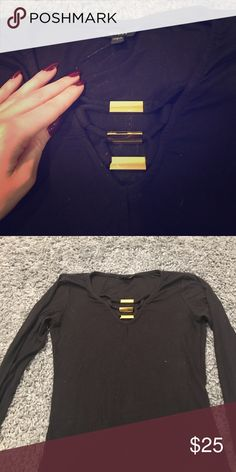 Black express long sleeve shirt Guess black long sleeve thermal shirt with gold embellishments on the neck line. Guess Tops Tees - Long Sleeve