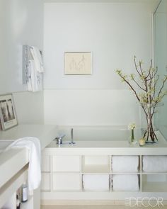 Elle Decor - October 2012 - Creative License: Inside the Home of C. Wonderss Michael Leva Bath with storage shelves.
