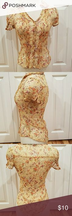 FRENCH CONNECTION FLOWERED TOP! Size small in GENTLY worn in very good condition!!! True to size. You will need You wear a camisole underneath. French Connection Tops
