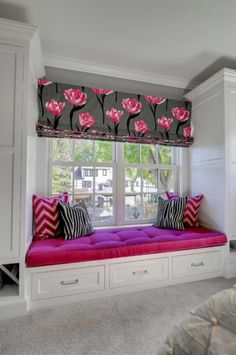 Grey, white, pink themed bedroom. Window seat.