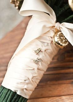 Make your bridal bouquet uniquely yours by adding your monogram. Have you and your loved one's initials stitched into your bouquet wrap or simply add lettered pins for a super sweet touch. #BridalBouquets #BouquetWraps