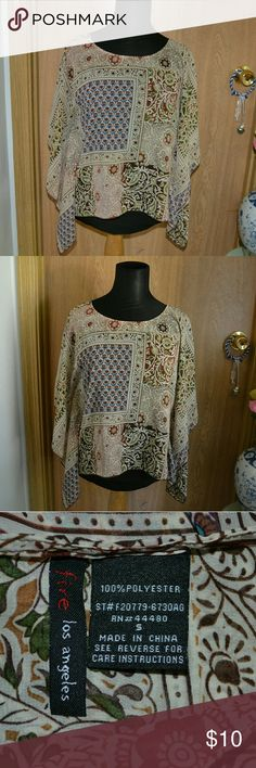 Fire los Angeles dressy blouse Smoke free home! NO HOLDS OR TRADES! I ship Monday-Friday! Buy 3 get one FREE! A beautiful sheer shirt size small by the brand fire los Angeles. In good condition. Perfect for summer , festivals and parties . 100% polyester. Fire Los Angeles Tops Blouses