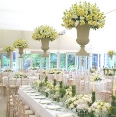 love this look - wonder how the urns are secured to the pedestals - you don't want one of these falling on your head!
