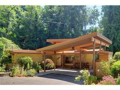 Mid Century Modern house - having this covered parking area would be a great place for solar panels!!!