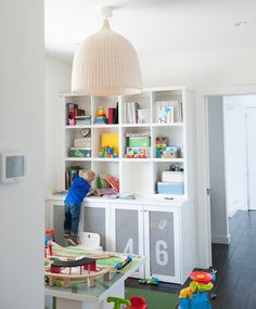 "style me pretty | playroom.  Curious if this can be done with 2 15"" deep Billy bookcases and an expedit or other similar cube shelf on top."